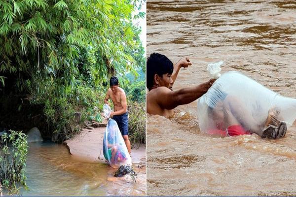 เด็กถูกนำใส่ถุงพลาสติก พาข้ามแม่น้ำไหลเชี่ยว เพื่อไปโรงเรียนอีกฝั่ง